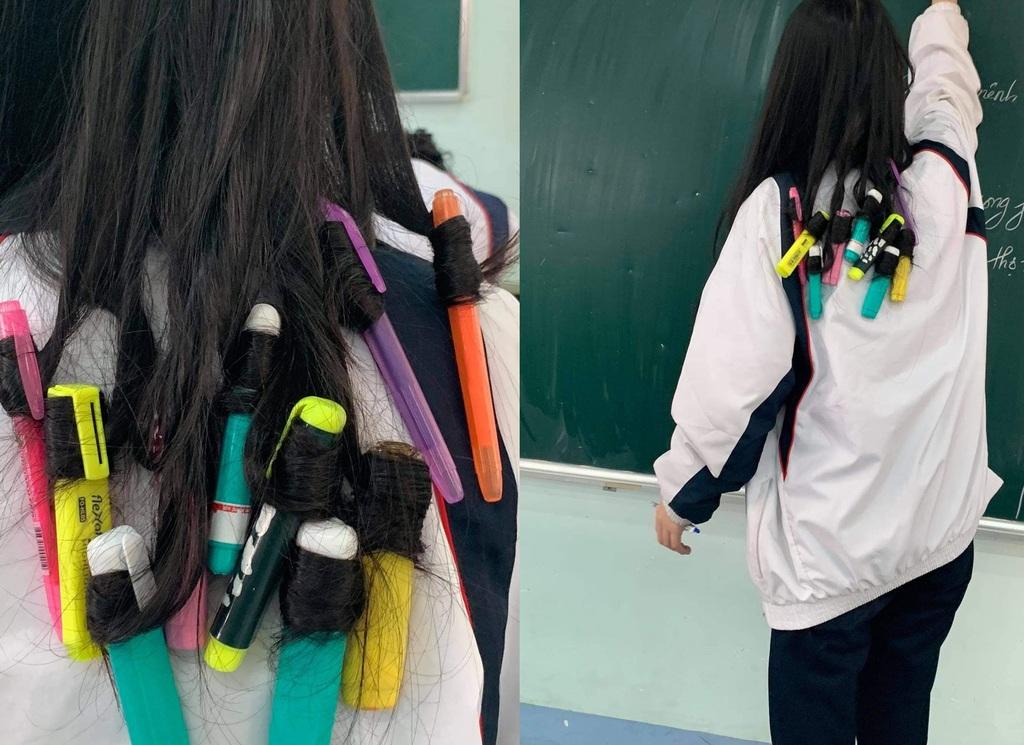 Muốn làm tóc xoăn nhưng không có dụng cụ, nữ sinh dùng một tá bút uốn tóc ngay tại lớp