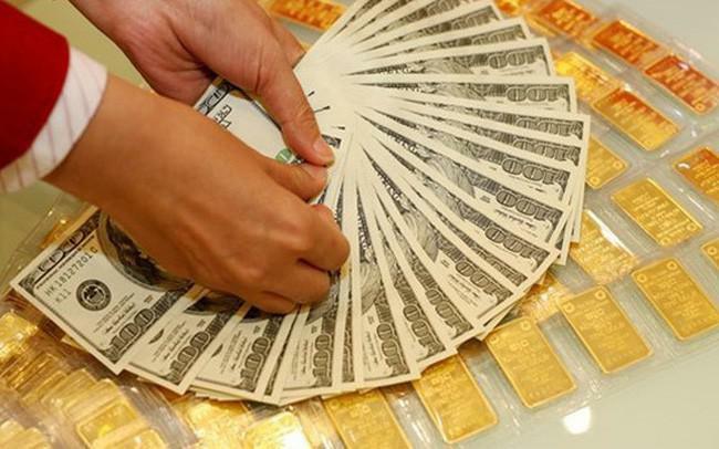 Giá vàng bật tăng, USD lao dốc