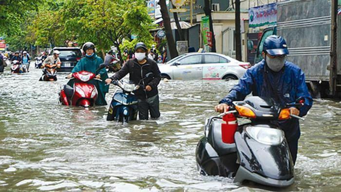 Xe máy bị ngập nước cần làm gì đầu tiên? - ảnh 1
